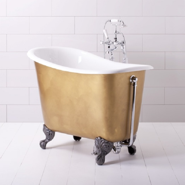 Small freestanding bath makes big bathroom splash for Small bathroom tub